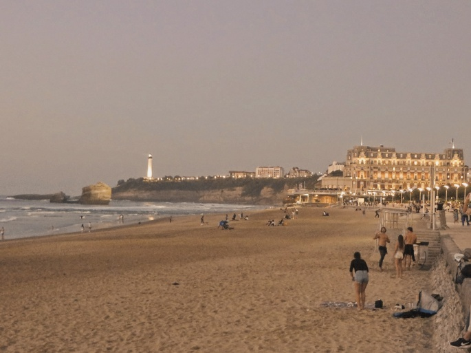 Dusk at the Grande Plage with the Hotel Palais in the back