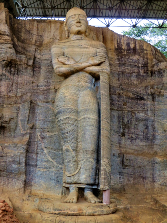 a Standing image carved in the rock, which is being debated as being Buddha or not