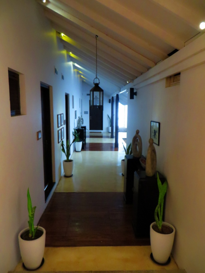 white hallways with dark wood accents
