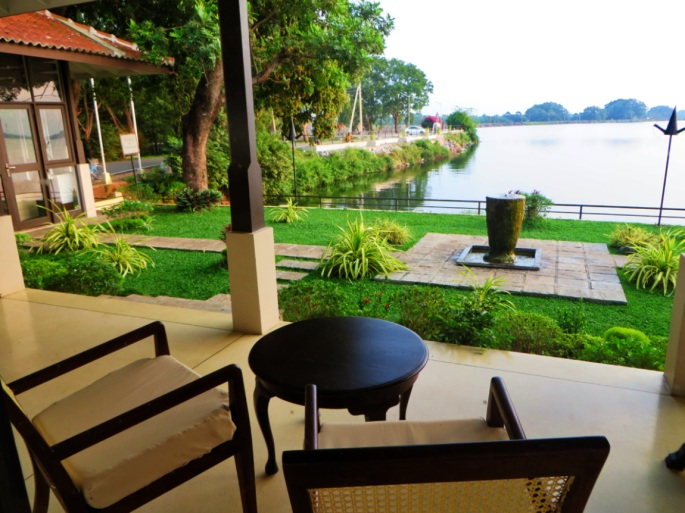 Sitting area in front of a small garden and a lake