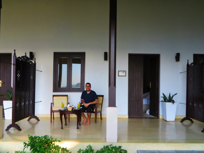 guest eats breakfast in the terrace outside his room at Ekho Lake House in Polonnaruwa