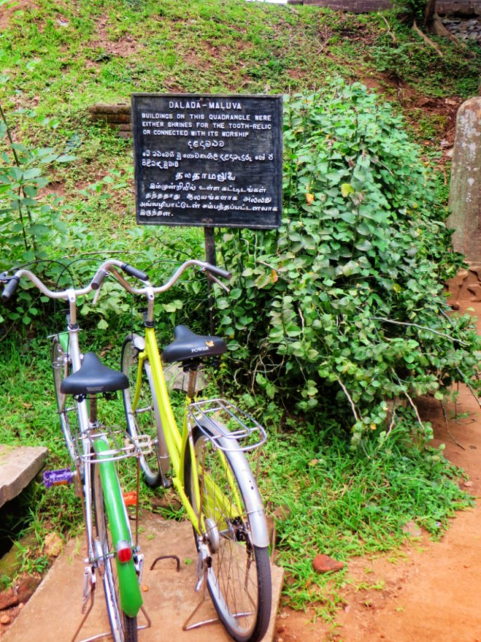 bikes parked by the ruins of the Sacred Quadrangle in Polonnaruwa in Sri Lanka