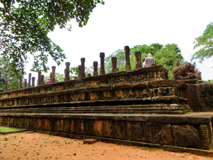 tourists visiting the royal audience hall of the King Parakamabahu complex in Polonnaruwa