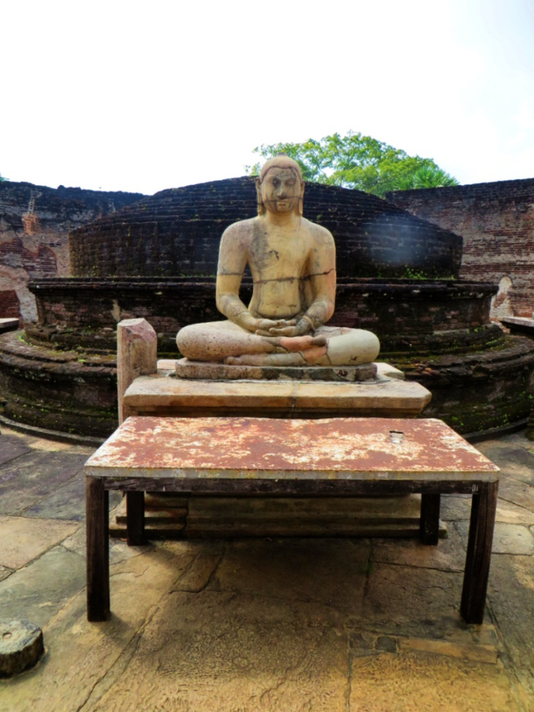 One of the seated Buddhas surrounding the main stupa at the second level of the Polonnaruwa Vatadage