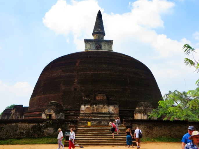 tourists explore the area around Rankoth Vehera, the largest dagoba in Polonnaruwa
