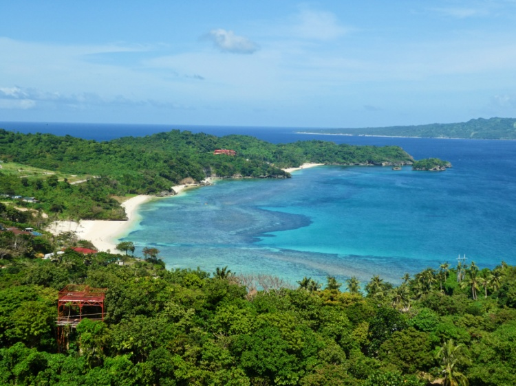 greenery, blue waters, and powdery white beaches on the other side of the island