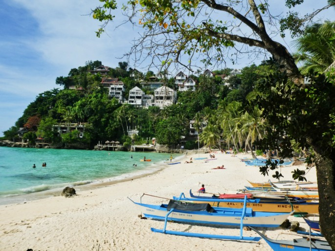 hotels on the cliff and the beach at Diniwid