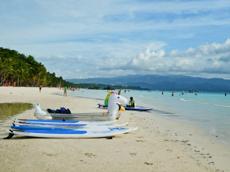SUP, kayak, and inflatable unicorn rentals on the beach