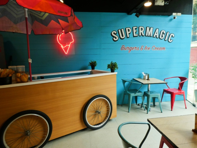 ice cream cart and seating of Supermagic burgers and ice cream shop
