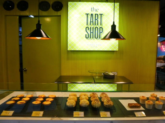 tart shop signage and display of tarts and other pastries