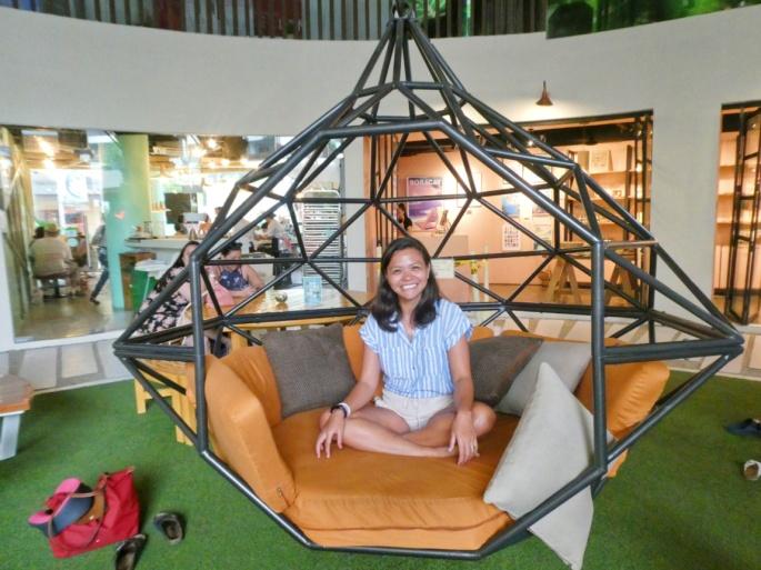 sitting in a giant swing
