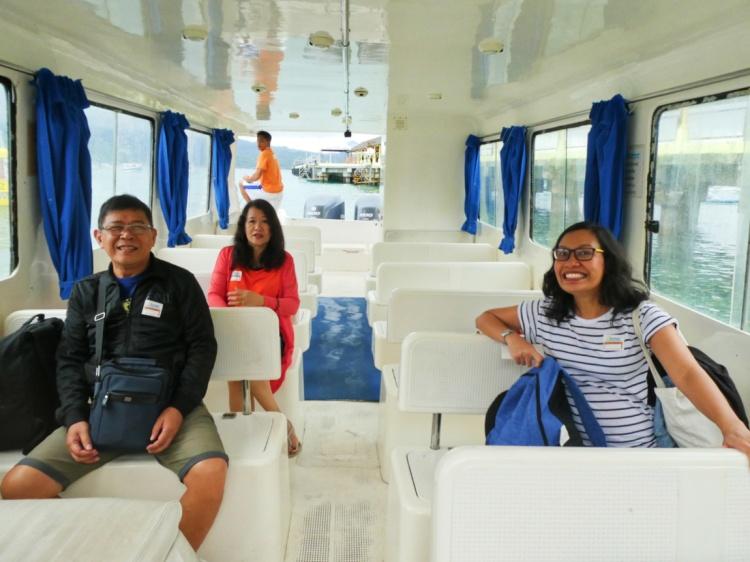 family inside a passenger speedboat