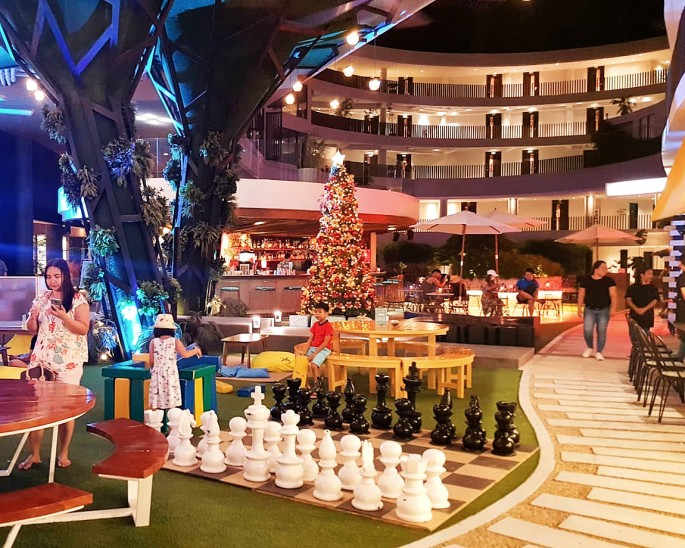 Kids playing near the giant chess set overlooking the resort
