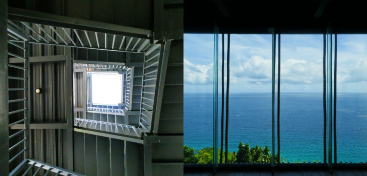 stairway of the building and a view of the sea from the glass walls