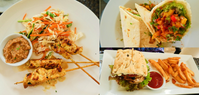 chicken satay with salad, fish sandwich with fries, and chicken mango burrito