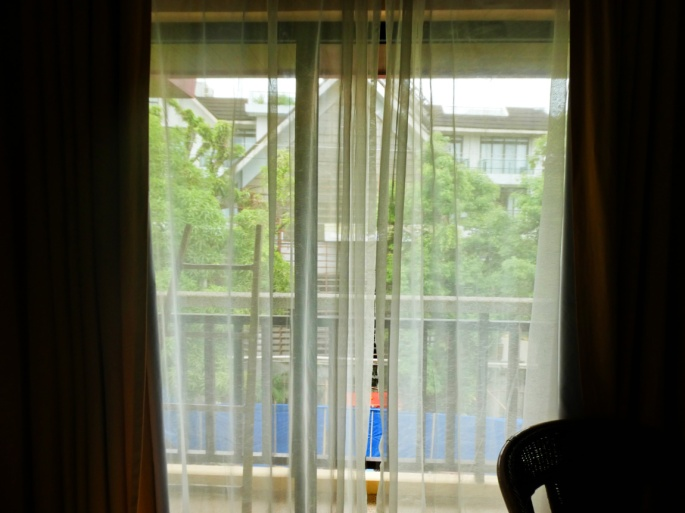 curtains and view across the terrace of the superior room