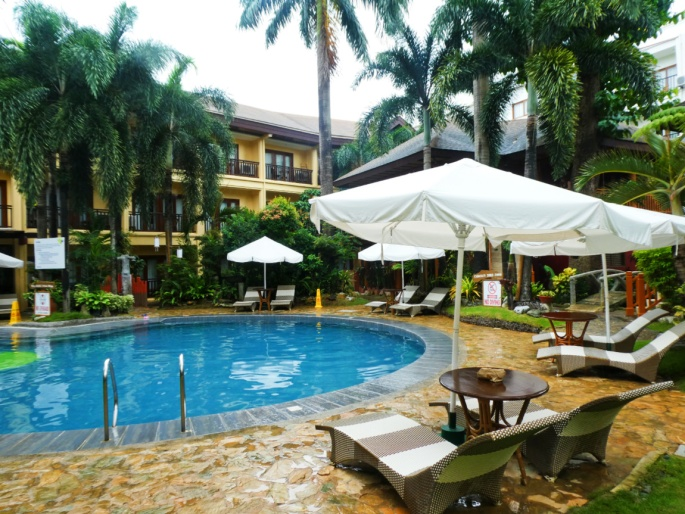 Pool, building, and outdoor lounge of the Boracay Tropics Resort