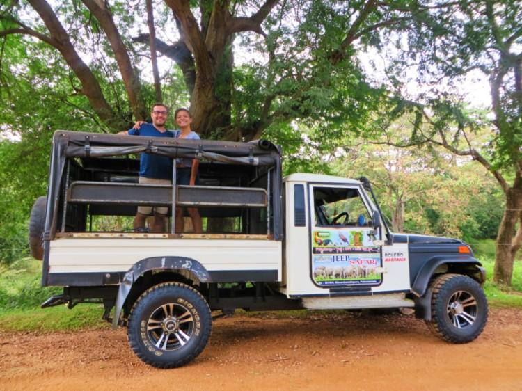 Couple in an open jeep on a safari in Minneriya Park