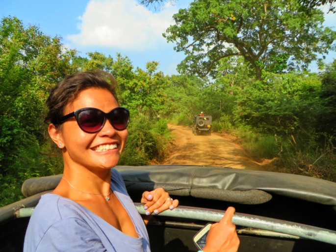 woman looking out of an open jeep headed into the heart of Minneriya Park