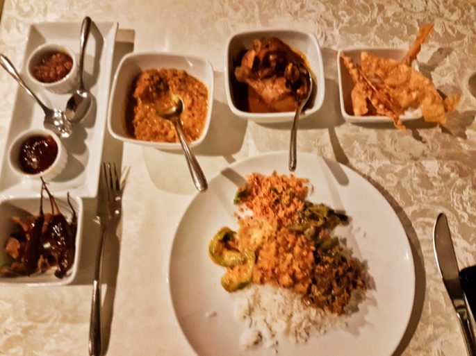 dinner of rice with curries, papa dom, and chutney in Ekho Lake House in Polonnaruwa