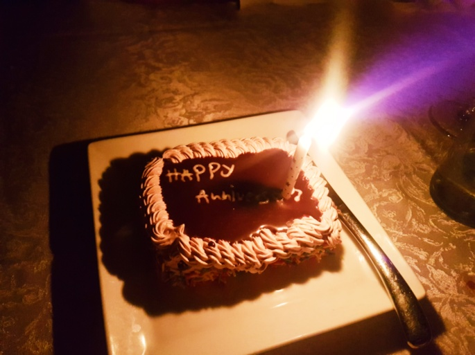 a chocolate cake and a single candle for dessert